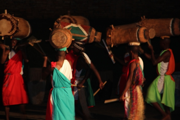 Male dancers from the Ndere Troupe carrying drums on their heads